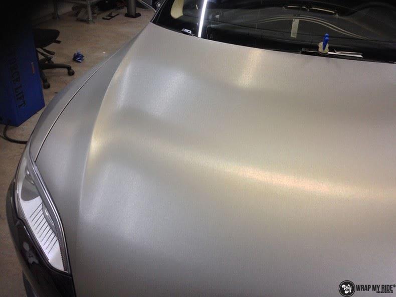 Tesla Model S brushed titanium, Carwrapping door Wrapmyride.nu Foto-nr:9085, ©2018
