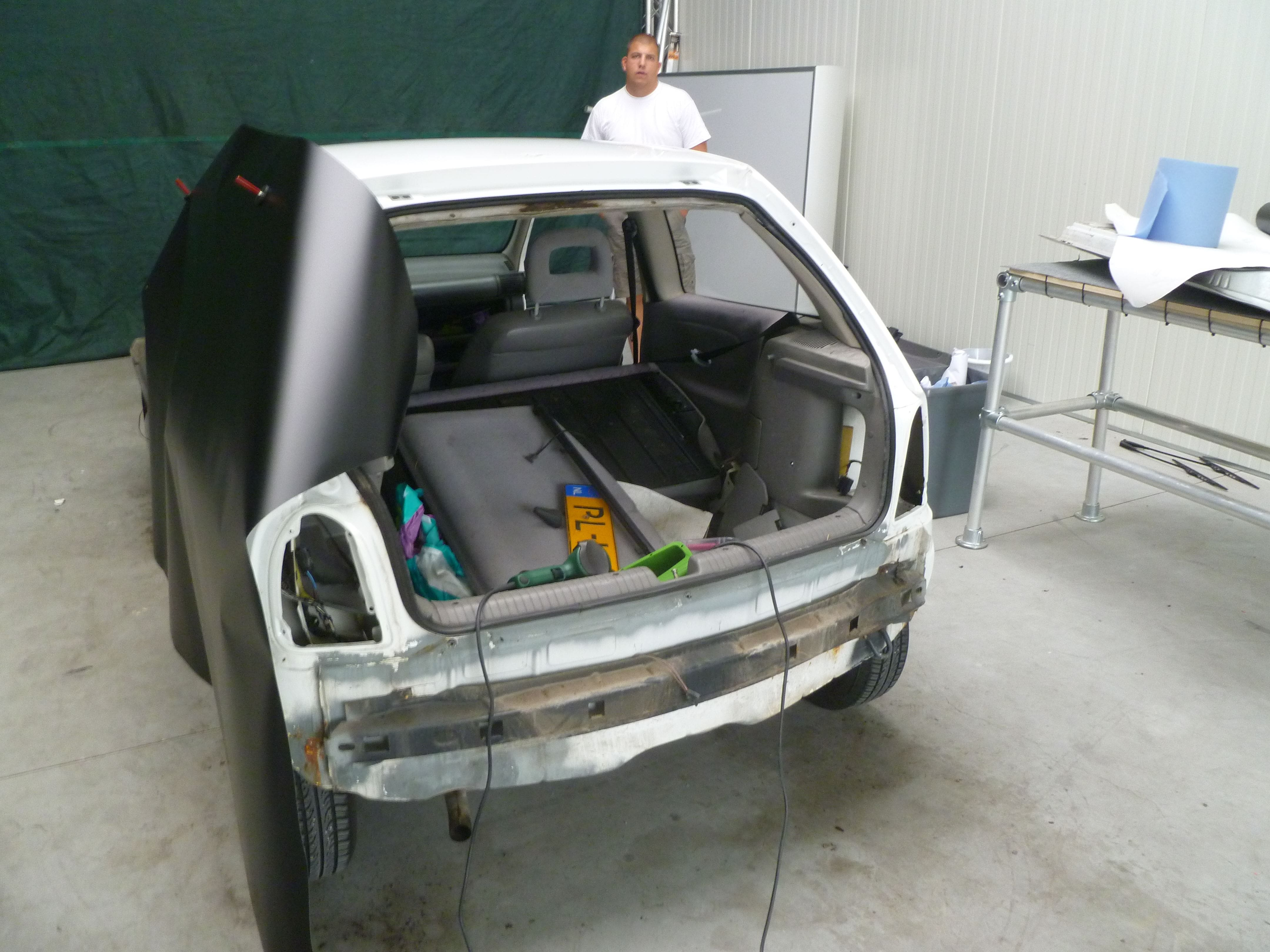 Opel Corsa B met Zwart Paarse Striping, Carwrapping door Wrapmyride.nu Foto-nr:6619, ©2021