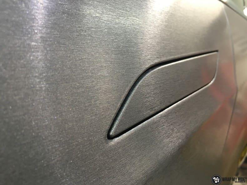 Tesla Model S brushed steel, Carwrapping door Wrapmyride.nu Foto-nr:9969, ©2018