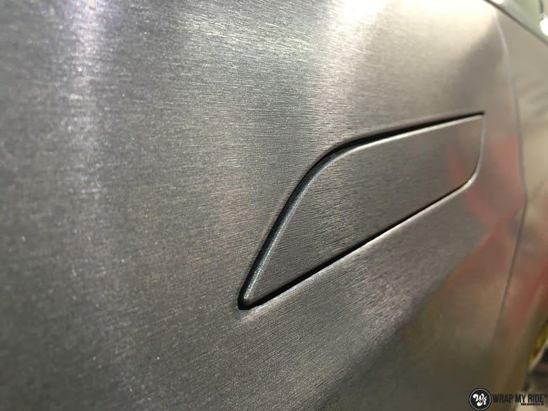 Tesla Model S brushed steel, Carwrapping door Wrapmyride.nu Foto-nr:9914, ©2018